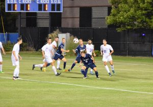 Anna Meassick | Sophomore Emil Jesman Sunde goes for a header as both teams desperately try to break the tie